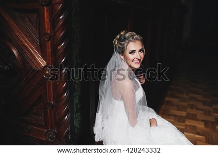 Sincere smile of the beautiful blonde bride - stock photo