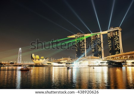 SINGAPORE - APR 5: Marina Bay Sands hotel light show at night on April 5, 2014 in Singapore. It is the world's most expensive building with cost of US$ 4.7 billion and landmark of Singapore. - stock photo