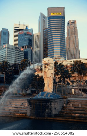 SINGAPORE - APR 5: Singapore city urban view with Merlion statue on April 5, 2013 in Singapore. It is 4th largest financial center and 1 of 5 world busiest ports. - stock photo