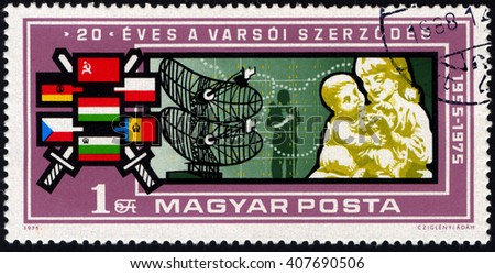 SINGAPORE APRIL 19, 2016: A stamp printed by Hungary to commemorate of 20th Century of Warsaw Pact,  circa 1975 - stock photo