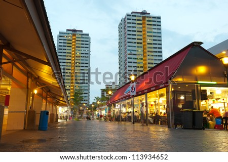 SINGAPORE - APRIL 27: An open air hawker centre or cooked food centre in a public housing complex in Singapore. April 27, 2011 in Singapore. - stock photo
