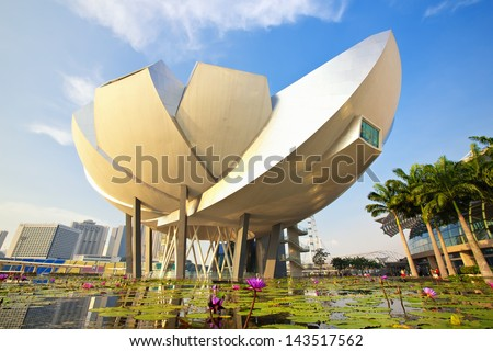 SINGAPORE - APRIL 5: ArtScience Museum on April 5, 2013 in Singapore. It is one of the attractions at Marina Bay Sands. It has 21 gallery spaces with a total area of 6,000 square meters. - stock photo