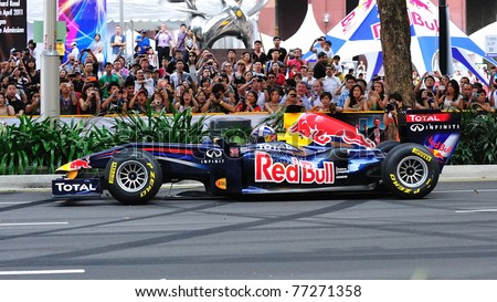 SINGAPORE - APRIL 24: David Coulthard driving the Red Bull Racing F1 car RB6 to perform stunts during Red Bull Speed Street Singapore on April 24, 2011 in Singapore.