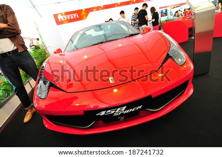 SINGAPORE - APRIL 12: Ferrari 458 Spider convertible sport car on display during Singapore Yacht Show at One Degree 15 Marina Club Sentosa Cove April 12, 2014 in Singapore - stock photo