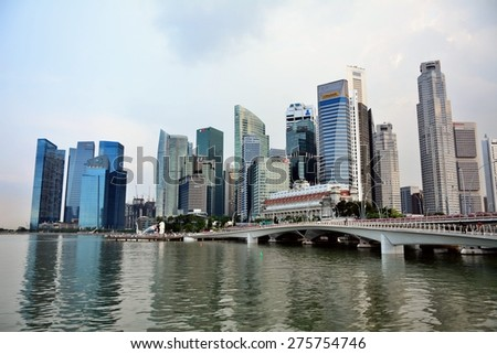 SINGAPORE - APRIL 30,2015: Financial district skyscrapers and the Jubilee Bridge at Merlion Park. A newly created pedestrian bridge at Marina Bay links Merlion Park to the waterfront promenade. - stock photo