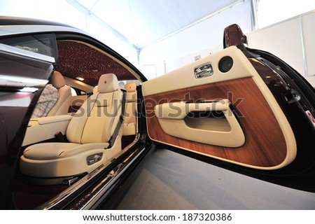 SINGAPORE - APRIL 12: Hand made unique interior of the Rolls Royce Wraith on display during Singapore Yacht Show at One Degree 15 Marina Club Sentosa Cove April 12, 2014 in Singapore - stock photo