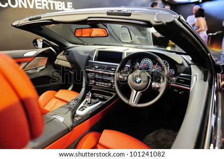 SINGAPORE - APRIL 28: Luxurious and sporty interior of BMW M6 Convertible at its Preview at Singapore Yacht Show April 28, 2012 in Singapore - stock photo