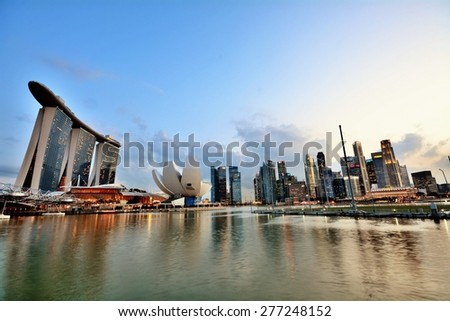SINGAPORE - APRIL 30,2015: Marina Bay Sands is an integrated resort fronting Marina Bay in Singapore.  - stock photo