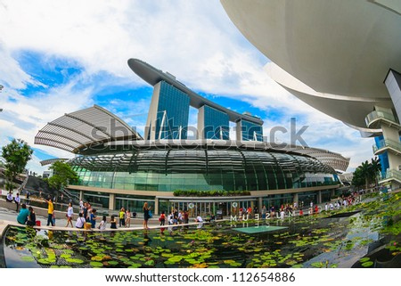 SINGAPORE-APRIL 6 : Marina Bay Sands Resort Hotel on April 6, 2012 in Singapore. It is billed as the world's most expensive standalone casino property at S$8 billion. - stock photo
