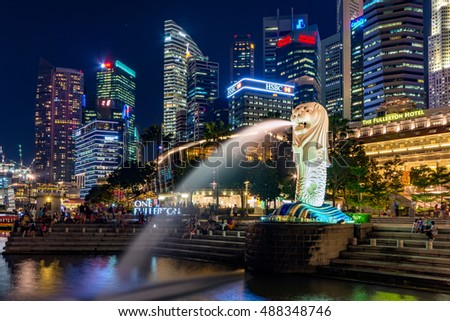 Singapore - April,2015: Merlion at Singapore Marina bay area. Marina Bay is a bay located in the Central Area of Singapore.