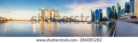 SINGAPORE - APRIL 2015: Newly build Jubilee bridge with famous singaporean landmarks: marina bay sands, singapore flyer, merlion, the CBD - stock photo