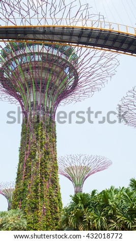 SINGAPORE - APRIL 10, 2016: Supertree Grooves over the blue sky. Supertree Grooves located in Garden by the Bay, Singapore. - stock photo