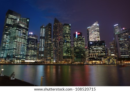 SINGAPORE - APRIL 23: The Downtown Core at night on April 23, 2012 in Singapore. It surrounds the mouth of the Singapore River and, and is part of the Central Area, central business district.