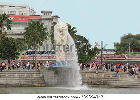 Singapore - April 7, 2013: The Merlion, a statue with a lion head and a body of a fish, has been the national personification of Singapore since July 20, 1966. - stock photo