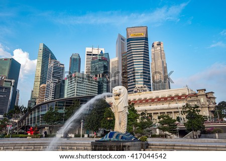 SINGAPORE - APRIL 19,2016 : The Merlion is a traditional creature with a lion head and a body of a fish, seen as a symbol of Singapore. - stock photo