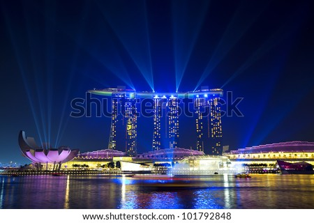 SINGAPORE  - APRIL 25: Wonder Full light show at Marina Bay Sands April 25, 2012, Singapore. Southeast Asia's largest light and water show.