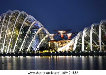 SINGAPORE-AUG 05:A night view of The Supertree Grove, Cloud Forest & Flower Dome at Gardens by the Bay on Aug 05, 2012 in Singapore. Spanning 101 hectares, five-minute walk from Bayfront MRT Station. - stock photo