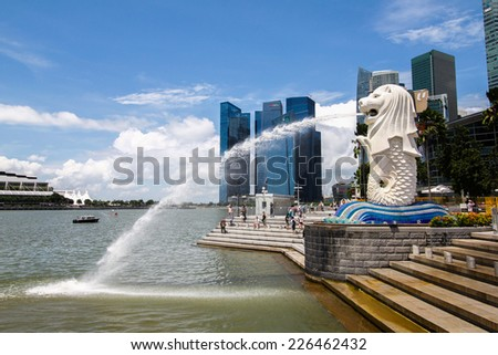 SINGAPORE -AUG 9: The Merlion fountain is famous landmark of Singapore on August 9, 2014. Merlion is a imaginary creature with the head of a lion and body of a fish, seen as a symbol of Singapore.