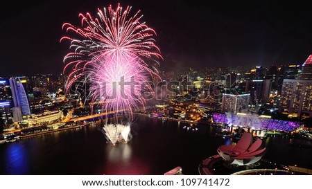 SINGAPORE - AUGUST 4: Aerial view of fireworks display from Marina Bay Sands during National Day Parade Singapore 2012 Preview on August 4, 2012 in Singapore.