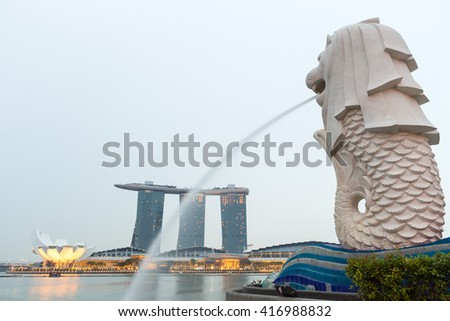 SINGAPORE - AUGUST 1, Merlion, Marina Bay Sand and Art Science Museum on August 1, 2015 in Singapore.They are the attractions of Marina Bay. - stock photo