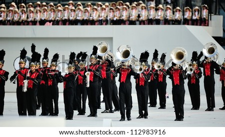SINGAPORE - AUGUST 09: Performance by school military band during National Day Parade 2012 on August 09, 2012 in Singapore - stock photo