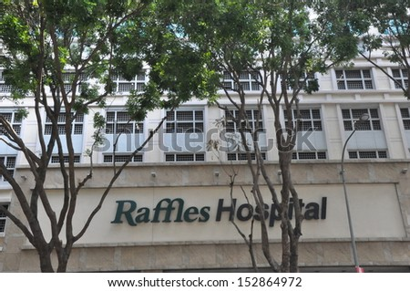 SINGAPORE - AUGUST 16: Raffles Hospital in Singapore, as seen on August 16, 2012. It is a tertiary care private hospital and the flagship of the Raffles Medical Group, a leading healthcare provider. - stock photo