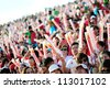 SINGAPORE - AUGUST 09: Spectators waving their clappers during National Day Parade 2012 on August 09, 2012 in Singapore - stock photo