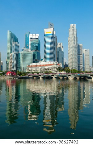 Singapore business district skyscrapers and Marina Bay in day - stock photo