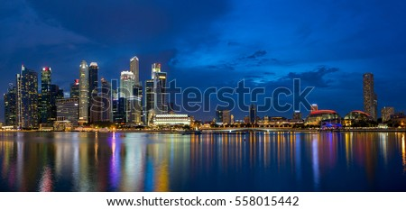 Singapore Central Business District Skyline by Marina Bay during Evening Twilight Blue Hour Panorama