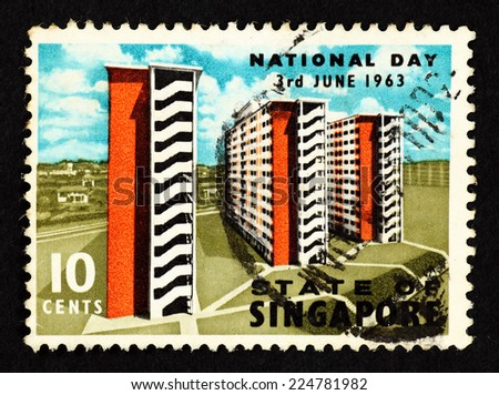 SINGAPORE - CIRCA 1963: Blue color postage stamp printed in Singapore with image of high rise residential urban flats to commemorate the National Day of the Republic of Singapore. - stock photo