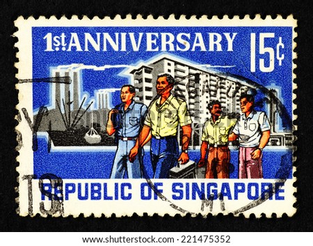 SINGAPORE - CIRCA 1966: Blue color postage stamp printed in Singapore with image of multi-ethnic Singaporeans in urban surroundings, to commemorate the first anniversary of the Republic of Singapore. - stock photo