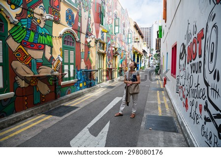 SINGAPORE - CIRCA FEBRUARY, 2015: Graffiti on the walls of old buildings Haji Lane. Haji Lane is the Kampong Glam neighbourhood famous for its cafes, restaurants and shops. - stock photo
