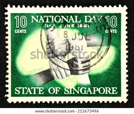 SINGAPORE - CIRCA 1961: Green color postage stamp printed in Singapore with image of interlocking arms to commemorate Singapore National day.  - stock photo