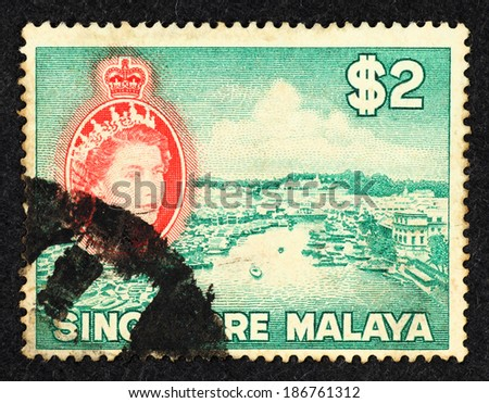SINGAPORE - CIRCA 1954: Green color postage stamp printed in Singapore with landscape image of Singapore city at the Kallang river mouth. - stock photo