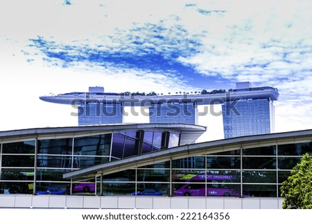SINGAPORE - CIRCA MAY 2014: The Marina Bay Sands Resort in Singapore. The roofs of towers are decorated with a park in the form of a ship 340 m long and capacity up to 3,900 people. - stock photo