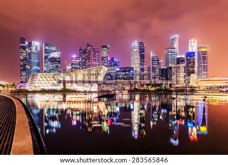 Singapore city at night with reflection - stock photo
