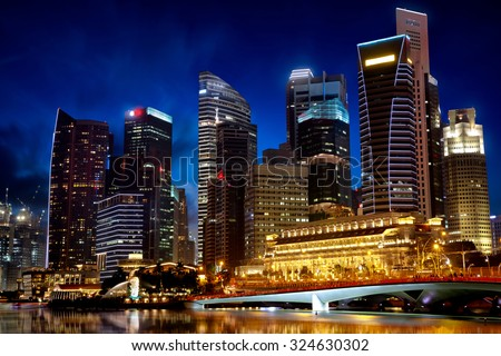 SINGAPORE CITY, SINGAPORE - AUGUST 22, 2015: Cityscape of financial district during twilight on August 22, 2015 at Marina Bay, Singapore. - stock photo