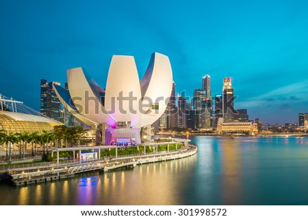 Singapore City, Singapore - July 18, 2015: Marina Bay skyline at twilight. The Marina Bay is a bay near Central Area in of Singapore, and lies to the east of the Downtown Core.
