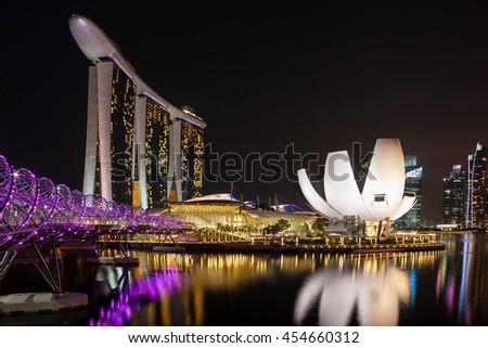 Singapore city, Singapore - July 17, 2016: The view to Marina Bay, bridge and museum at night - stock photo