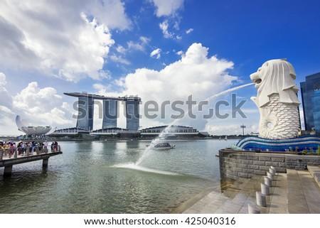 Singapore City, Singapore - June 1: View of Singapore landmarks Merlion statue and Marina Bay Sands hotel in Singapore City.  - stock photo