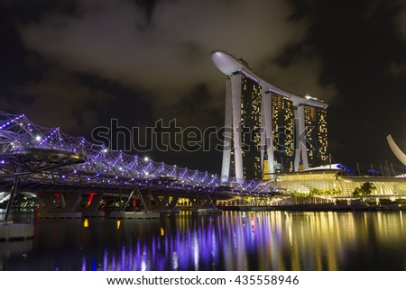 SINGAPORE CITY, SINGAPORE - MAY 28: Helix bridge and Marina Bay Sands at night on May 28, 2016 in Singapore.