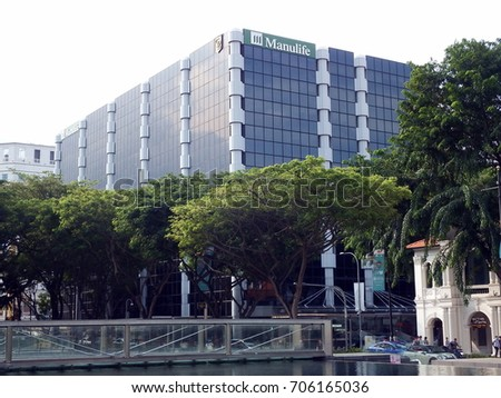 Singapore City, Singapore - May 1st, 2016: View of the Manulife Centre, also known as Plaza By The Park, Bras Basah Road, Singapore City. Manulife is a Canadian insurance company.