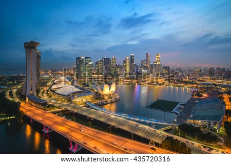 Singapore city skyline at Marina Bay at night - stock photo