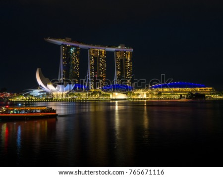 Singapore cityscape at night. There is a bridge Helix and Marina Bay, november, 2017