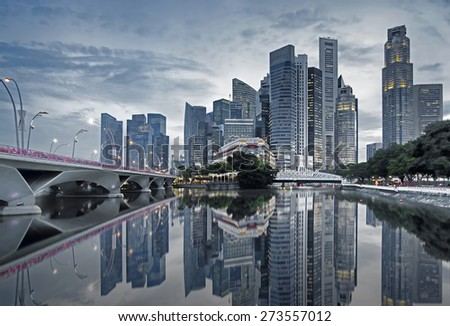 Singapore cityscape casting reflections in the early morning - stock photo