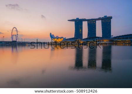 Singapore cityscape, the modern buildings of Singapore skyline in business district with sunrise and reflection in water of Marina Bay, the Republic of Singapore, global city in Southeast Asia.