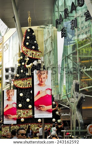 SINGAPORE - DEC 29: Christmas Decoration at Singapore Orchard Road on December 29, 2014 in Singapore. The street with colourful christmas trees, ball, stars & dressed-up shopping centres. - stock photo