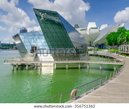 SINGAPORE-DEC 30, 2015: Façade of Louis Vuitton store, a luxury shop designed by architect Peter Marino in Marina Bay. LV is founded in 1854 is one of the world's leading international fashion houses