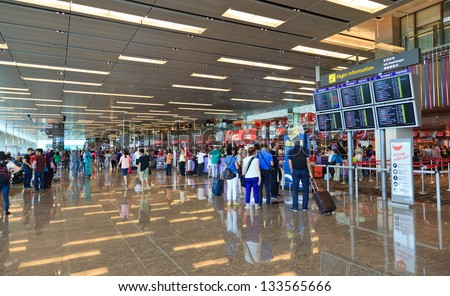 SINGAPORE -DEC 30: Interior of Changi airport on December 30, 2012 in Singapore.  Airport is major aviation hub in Asia with throughput exceeding 51 mln passengers per year. - stock photo