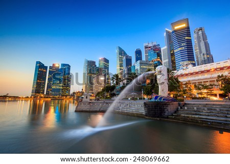 SINGAPORE-DEC 16, 2014: Merlion statue fountain in Merlion Park and Singapore city skyline on December 16, 2014. This fountain is one of most well known icons of Singapore  - stock photo